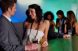 Flirting: Body Language. istockphoto/kupicoo