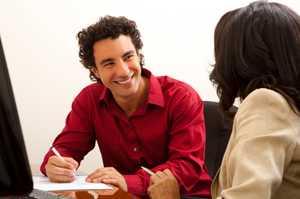 The Professional Negotiator takes notes. istockphoto/MichaelDeLeon